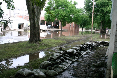 Walls of sandbags failed to protect homes near the Cedar River in Vinton during the Flood of 2008.