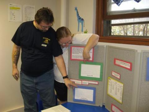 Kenny and Kim Petersen check out the charts marking their son's progress at home.